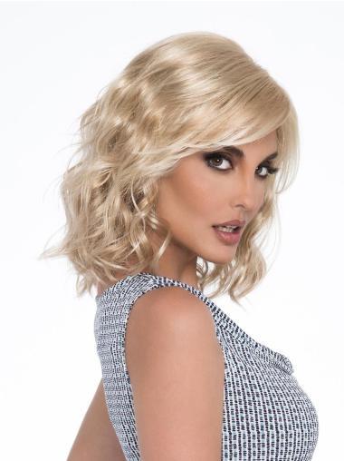 Layered Platinum Blonde Wavy Shoulder Length Mono Part Wigs